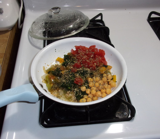 Heated the onions, peppers and spinach covered for 3 min, stirred, covered and heated 3 min more. Added garbanzo beans, tomatoes and spices, heated for 3 min and stirred.