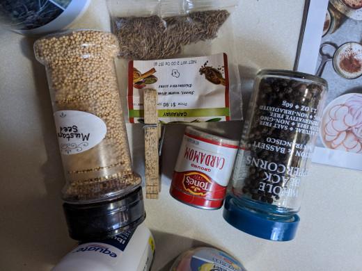 Black peppercorns, Mustard seed, cardamom, dill weed, Caraway seeds