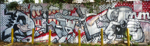 Fencing around Cecil's Pub with NEKST Graffiti Mural