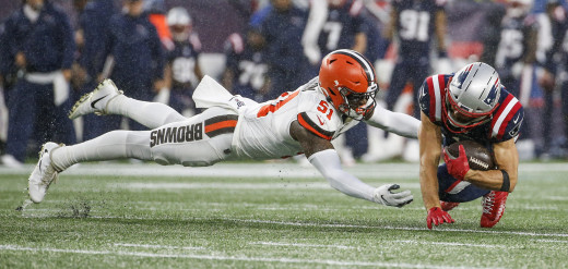 Cleveland Browns linebacker, Mack Wilson (51), dives to tackle New England Patriots wide receiver, Julian Edelman, during a 2019 game. Wilson is the only linebacker to return to the Browns for the 2020 season.