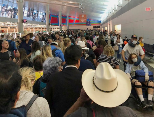 In this photo provided by Austin Boschen, people wait in line to go through the customs at Dallas Fort Worth International Airport in Grapevine, Texas, on March 14, 2020. Austin Boschen—AP