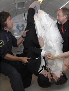 Photo courtesy of http://www.telegraph.co.uk/news/newstopics/howaboutthat/5596173/Head-over-heels-couple-get-married-in-zero-gravity.html
