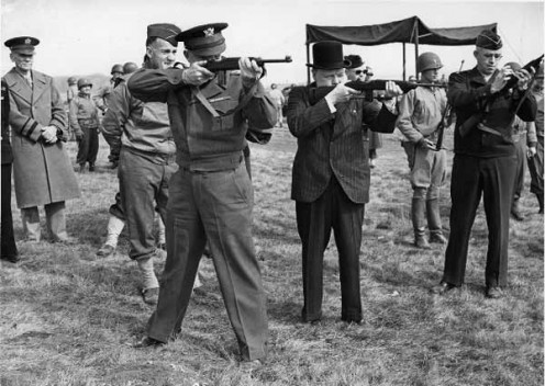 L-R: MG Edward H. Brooks (observing), GEN Dwight D. Eisenhower, PM Winston Churchill and LTG Omar Bradley shooting the M1 Carbine during preparations for Operation Overlord.
