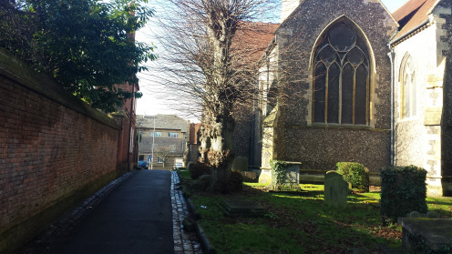 The westernpost stretch of Church Street, in Reading, is little more than a path through the churchyard of St. Giles' Church.