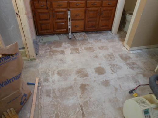 Tiles up exposing the bare floor