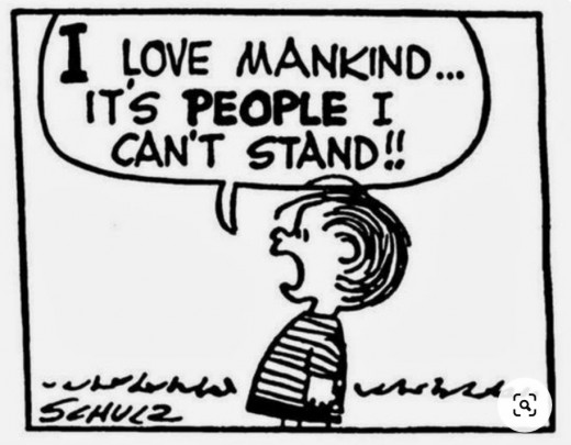 If Charles Schulz drew big buildings behind Linus, and a crowd of people willfully ignoring him, he'd have New Yorkers pegged.