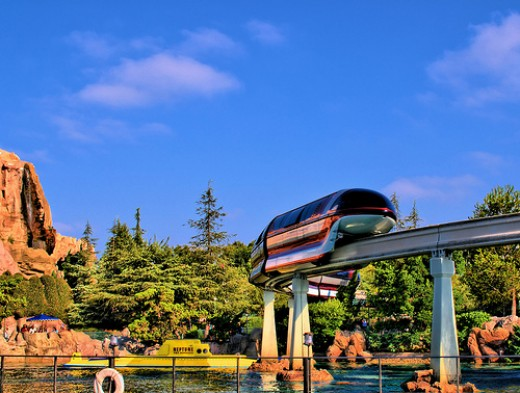 Only at Disneyland could you have a monorail traveling over a submarine with a mountain in the background