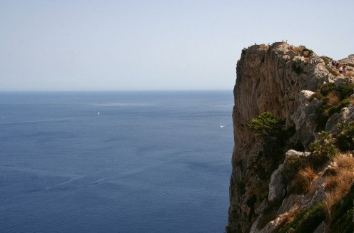 This photo shows a cliff overlooking what is down below and it also symbolizes part of this album's title.