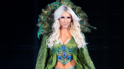 20. Charlotte Flair Just like her Father, Charlotte has gone on to do great things. Her theme music also defines Royalty. A classy theme fit for the Queen