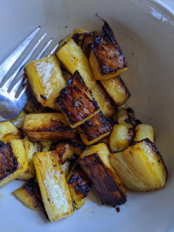 Fresh Pineapple fried in a Pan in Butter