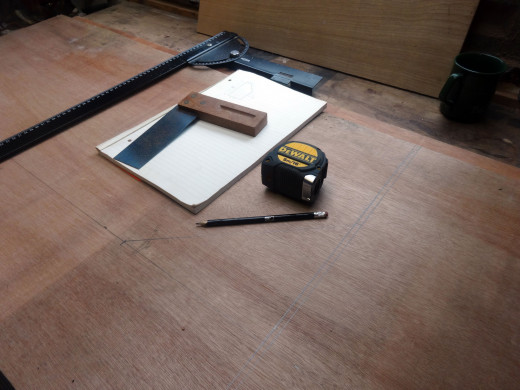 Measuring and marking out the height of the side panels and slope to match the writing desk bureau profile.