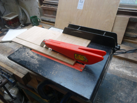 Using a table saw, with guide, to cut all the 9mm plywood to the same width, for the drawer supports, and top.