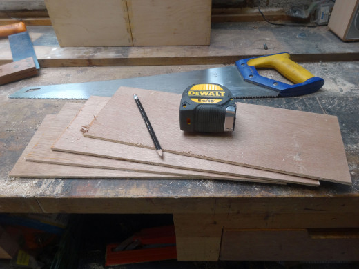 Cutting sacrificial spacers from 4mm plywood, to the same size as the pairs of joined drawers; ready for use during assembly of the storage unit.