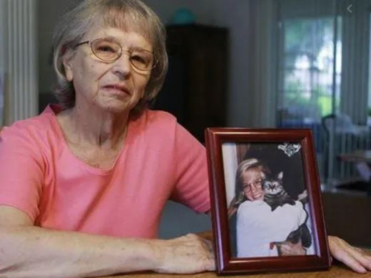 JoAnn Zywicki with a photograph of her daughter Tammy Jo Zywicki who was murdered in 1992.