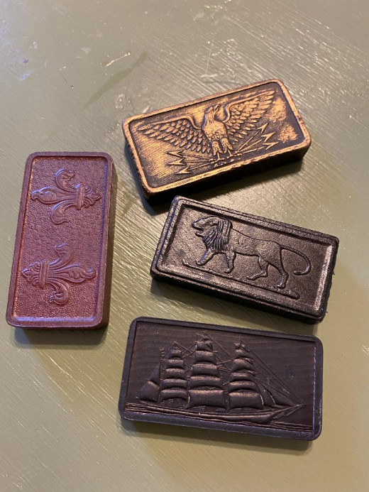 These are some of the different kinds of dominoes in my collection. I love them all.The eagle domino is prepped with gold antiquing rub.