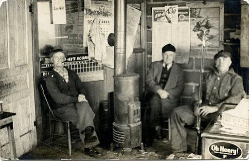 Washington State Historical Society enjoy a good talk by the stove.
