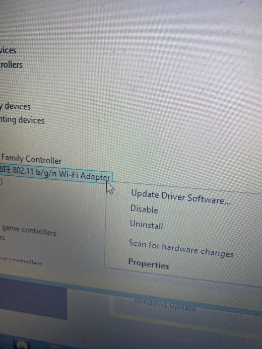 You'll need to uninstall your Wifi Adapter. Also notice the option of scanning for hardware changes, which you'll need to use later in this operation.