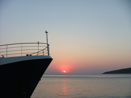 Sunrise and boat on the island Tilos in Greece