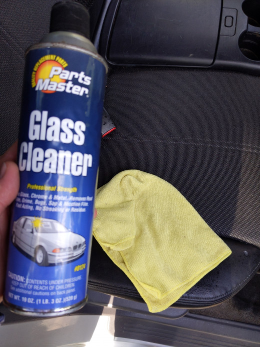 Clean windows with window cleaner and rag, in this case, microfiber towel