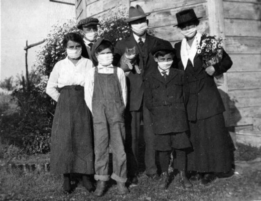 Family wearing masks during the 1918 pandemic (note the cat!)