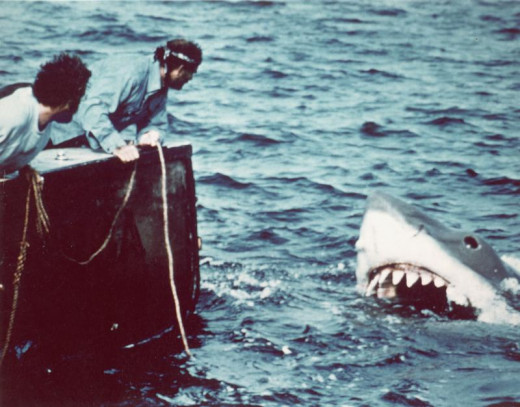 """Actors Shaw and Dreyfuss aboard the """"Orca"""" spotting the great white, 1975"""