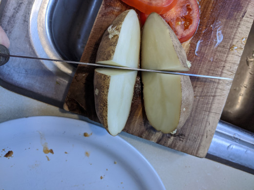 Cut potato so that there are eyes on each piece