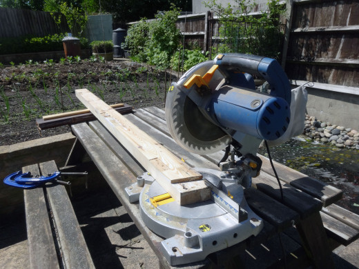 Trimming the ends of the old doorframe square with an electric mitre saw.