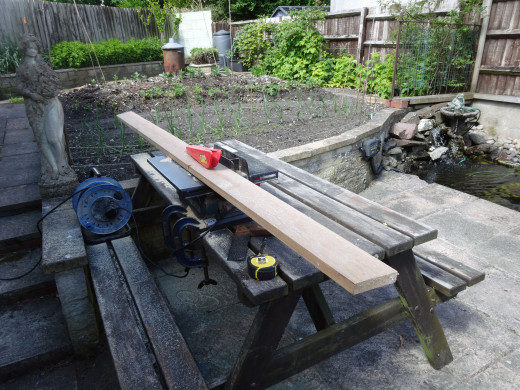 Bench saw used to cut timber in half, lengthwise; for making frame for the front panel.