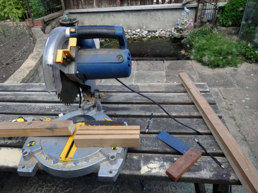 Cutting the three rails of the frame to size with the mitre saw.