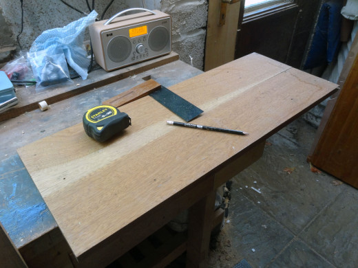 Marking out the wood for cutting the shelves to size.