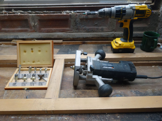 Router and router bits used for routing the glass recess and decorative mouldings.