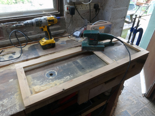 An orbital sander with a fine grade grit used to give a good smooth finish to the surface.