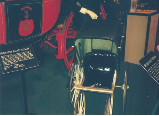An antique baby carriage.