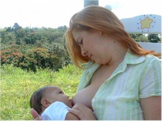 A mother nursing in public.