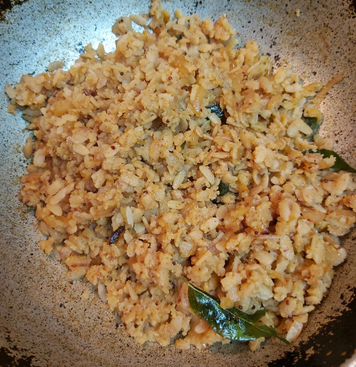 Toss well until all the spices coat well and evenly with poha. Mix gently without breaking the grains. Cook for 1-2 minutes in low flame and switch off the flame.