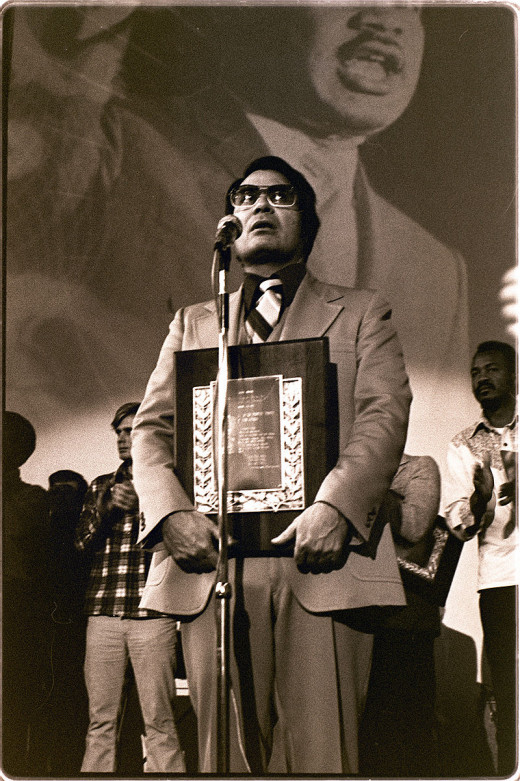 Jim Jones, founder of the cult Peoples Temple, accepts the Martin Luther King award less than 2 years before his death in the largest mass suicide in American history.