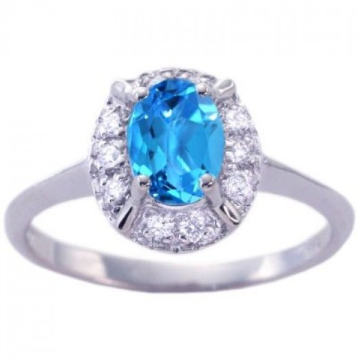An example of an engagement ring with a blue topaz gemstone