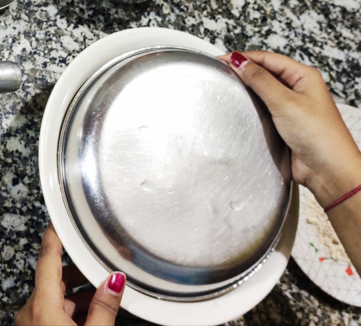 Covering the  dough with a plate