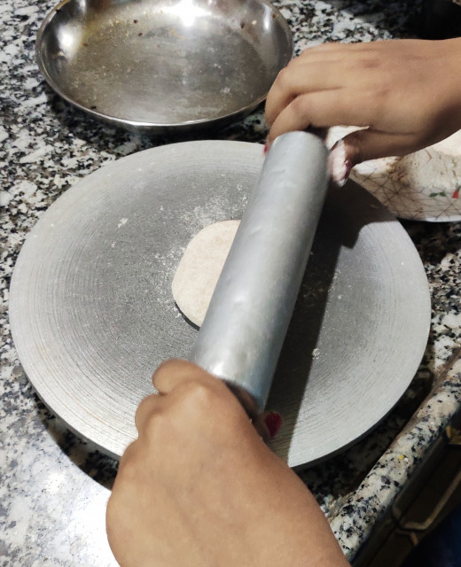 Rolling the ball using rolling pin