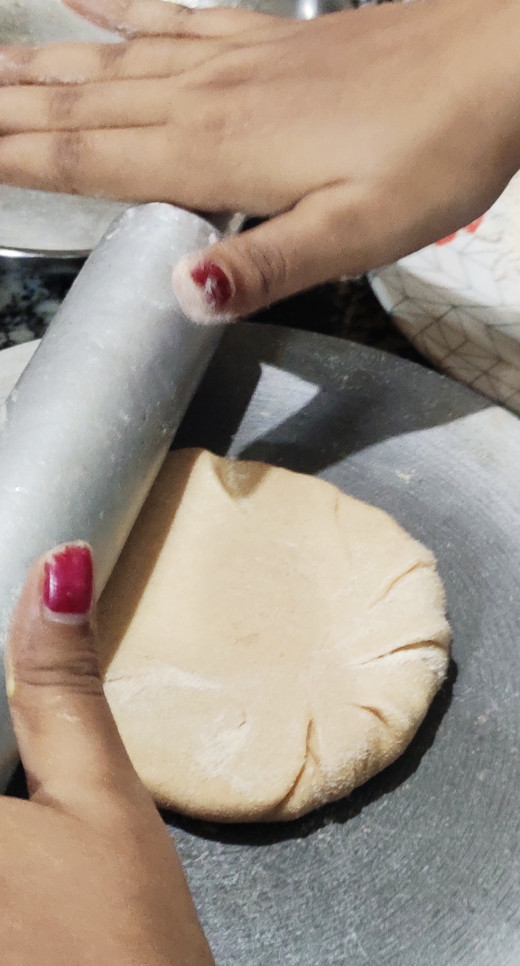 Rolling the paratha