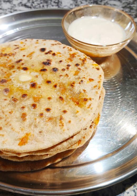 Gajar- Chhena paratha served with curd