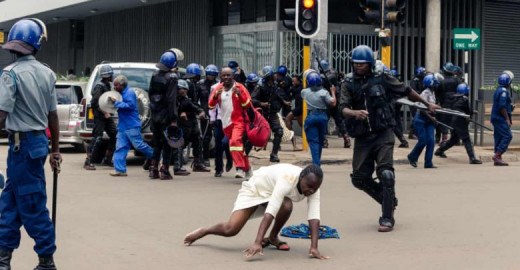 Police beating a defenceless woman in Harare, Zimbabwe