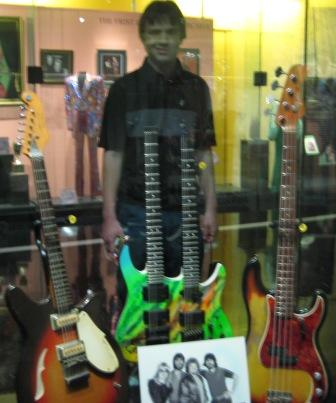 This photo is of me standing behind some guitars at the Country Music Hall Of Fame. The double green one in the middle belonged to Alabama! They are so cool.