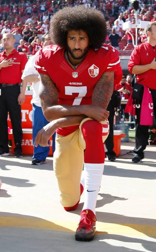 Colin Kaepernick of San Francisco 49ers Kneeling During the National Anthem