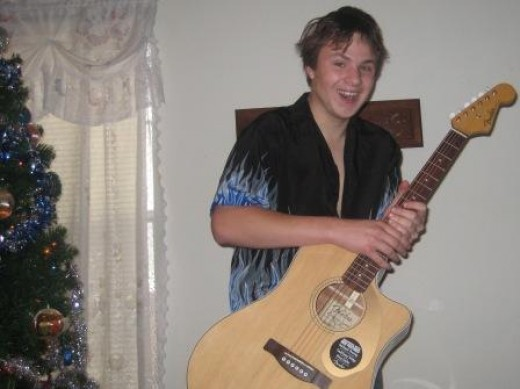 Matthew Schulze and his Fender electric acoustic guitar, Christmas 2008.
