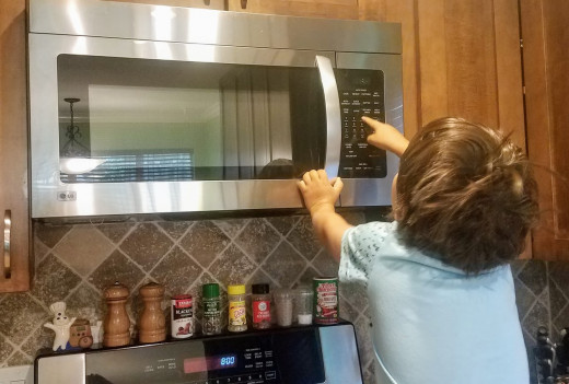 My five-year-old son using the microwave