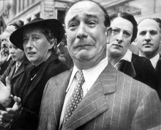 A French man in Marseilles crying as French army banners of dissolved units are evacuated to North Africa: war and defeat were no light matters in 1940