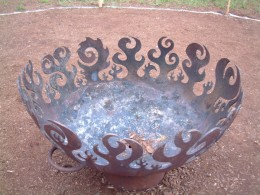Fire Tribe Hawaii's gorgeous, custom fire bowl made from the end of a recycled propane tank.