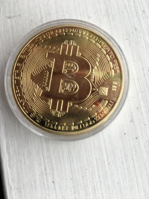 Photo of gold plated bitcoin replica.