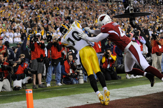 Pittsburgh Steelers wide receiver Santonio Holmes catches a touchdown pass as Arizona Cardinals safety Aaron Francisco defends during the fourth quarter of the NFL Super Bowl XLIII football game, Sunday, Feb. 1, 2009, in Tampa, Fla.